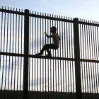 Child-on-Mex-barrier