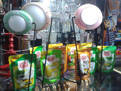 Essmart's solar lamps on display along with a range of Indian pickles at a local store in Tamil Nadu. (Credit: Rhitu Chatterjee)