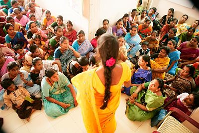 """From the Global Fund's blog: """"At an HIV support group meeting in Kakinada, India, women share their experience of living with HIV. The number of participants has been increasing steadily as more people become willing to disclose their status. Global Fund support allows centers such as these to provide health services and social support along with vocational training."""" (Copyright: The Global Fund / John Rae)"""