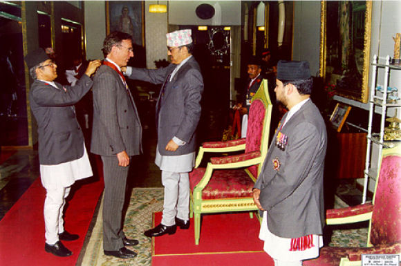 Tucker is presented with award by King Birendra of Nepal