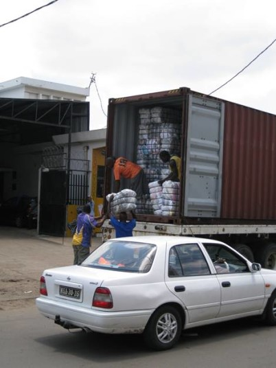 Unloading bales in Mozambique.