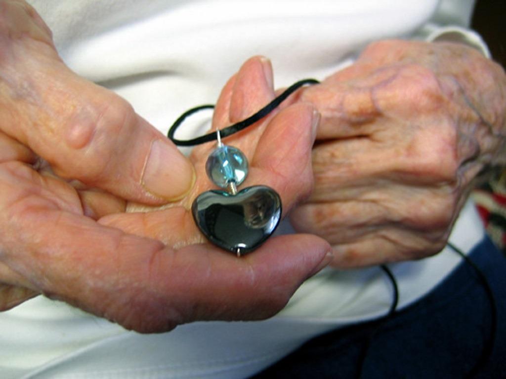 Elderly-and-pendant