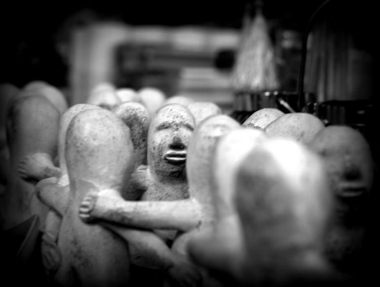 Statues-touching