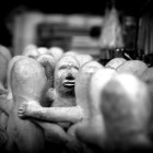 Statues-touching-small