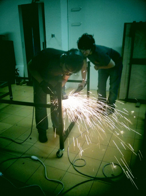 Two men welding, as an example of how maker spaces are getting grants from philanthropy.