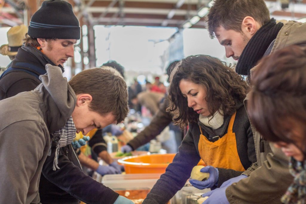 Alex Barnard, top left, participates in an event called Disco Soupe, which prepares meals from discarded food in public places (photo courtesy of Barnard).