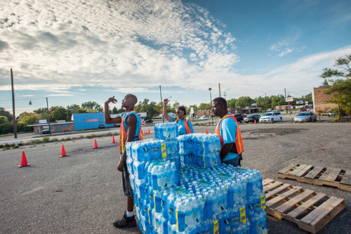 """City of Flint, Michigan water, filter distribution, and sample turn-in, on Wednesday, October 5, 2016. While U.S. Department of Agriculture partners may have water available for residents, the responsibility here has been taken on by the City of Flint, with """"Water Pickup"""" locations in each of its Wards, such as this on in Ward 8. USDA photo by Lance Cheung"""