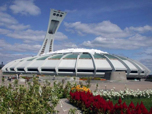 Asylum Seekers Start Arriving To Montreal's Olympic Stadium