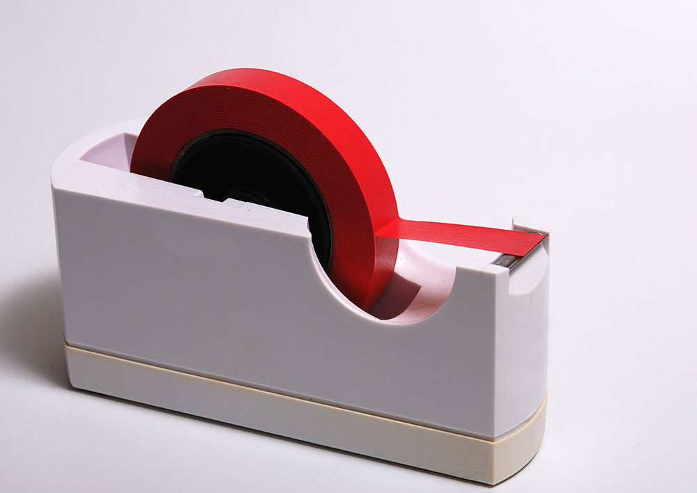A dispenser of red tape.