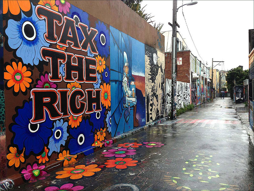 "A mural in San Francisco that reads ""Tax The Rich."""