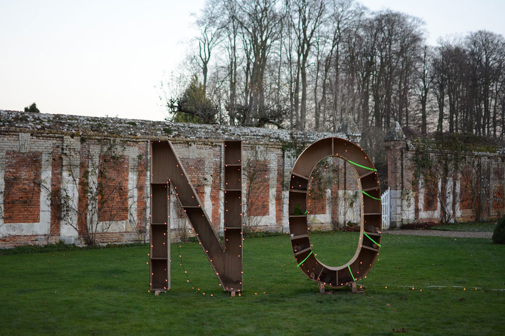 "The word ""No"" erected in large letters in a garden, festooned with lights."