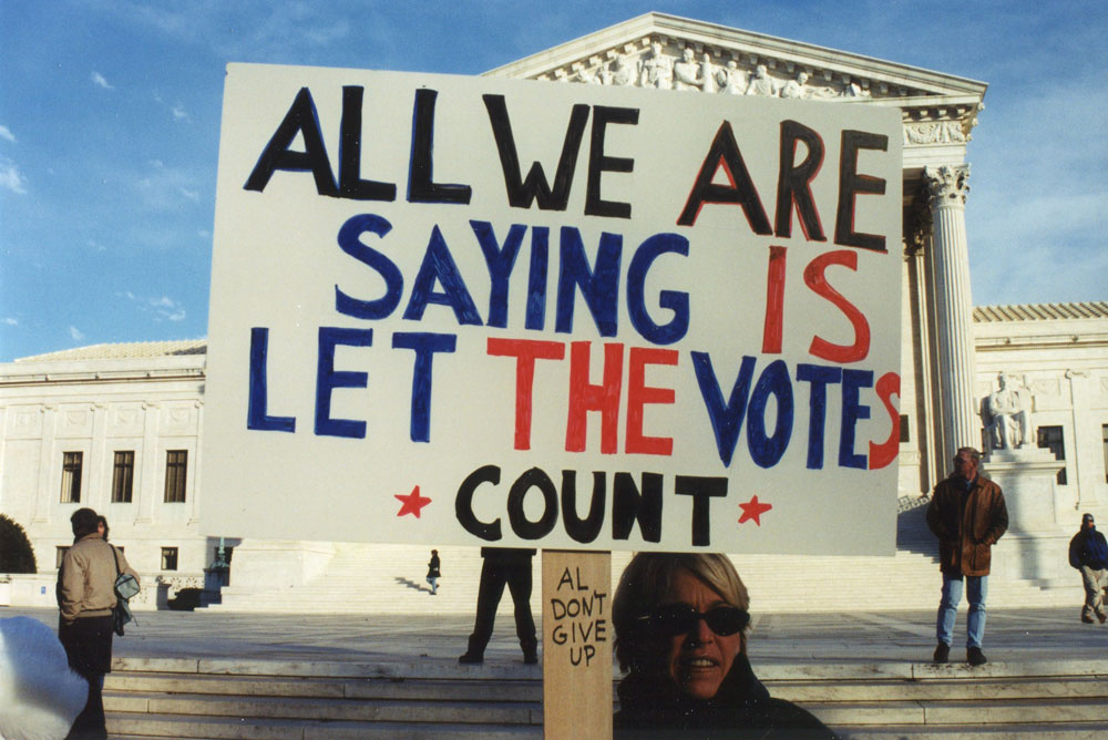 ALL WE ARE SAYING IS LET THE VOTES COUNT protest sign at Presidential Election 2000 Protest at the US Supreme Court on Maryland Avenue between Maryland Avenue and East Capitol Street, NE, Washington DC on Sunday, 3 December 2000 by Elvert Barnes Protest Photography